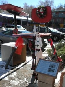 Sculpture in Manitou Springs, date uncertain. At some point after 1999 the chair was painted red. Photo from the Manitou Springs Arts Council.